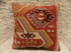 Kilim Pillow Cover  This is an authentic Turkish decorative pillow cover made from an original handwoven kilim rug.  The original rug is made of finest wool,aged 20-90 years  The backing is cotton fabric,closed with an invisible soild zipper.it is clean unused and in good condition.  Size:16x16inch(40cmx40cm)  Care:dry clean onley  Shipping: I ship worldwide by UPS FEDEX delivery takes 5 working days max with tracking number.  Pillow insert is not included Thank you for visit my shop!      b