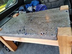"This table is made of a 2"" thick concrete top with embedded glass. The top was polished to expose the glass and aggregate of the concrete. The base is made of rough sawn cedar 4x4 for the legs and 2x4 for the frame. The top was polished to 800 grit for a smooth finish. Dimensions are 36"" long x 21"" wide x 18"" tall at the concrete top."
