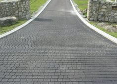 Everything you need to know about asphalt driveways. Includes Concrete vs an asphalt driveway, stamped asphalt options, asphalt contractors and more. Driveway Tiles, Driveway Design, Driveway Entrance, Patio Design, Stone Landscaping, Driveway Landscaping, Outdoor Landscaping, Backyard Patio, Asphalt Driveway