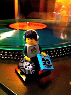LEGO figure with record amd sleeve in hand stood in front of a lifesize record and turntable Vinyl Music, Dj Music, Dance Music, Music Is Life, Vinyl Records, Music Stuff, House Music, Lps, Lego Star Wars