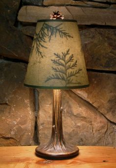 These beautiful lamps are handmade in the Adirondacks by Northeast Living Lights. The lamp features a cast metal base shaped like a tree with roots and the base is rubbed with an antique bronze patina finish. The shades are handmade from a neutral green mottled paper or speckled french vanilla - featuring preserved woodland leaves. All finials are real pinecones, acorns or twigs, hand-crafted to fit each lamp. Available on CampFitters.com under Cabin Decor > Lighting > Lamps. #LodgeDecor