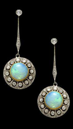 A pair of Belle Epoque opal, diamond, platinum and eighteen karat gold screwback earrings, circa 1915. Length: 1 3/4in. (screwbacks of a later date)