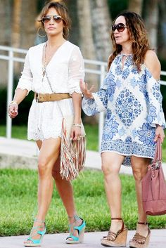 A lace romper with scallop hems is worn with teal lace-up wedge sandals, a fringe crossbody and gold hoops; A cutout shoulder blue and white patterned chiffon dress is worn with wedges and a burgundy hobo bag.