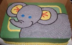 A simple elephant cake using fondant and royal icing piped on the top for the elephant image.