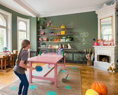 A pink pingpong table how cool is that. And the rug is great too
