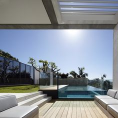 Impossibly Chic Pool Area by Tobias Partners