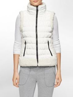 a quilted vest crafted of high tech quick dry moisture wicking fabric with a faux shearling trim to take you to and from your workout.