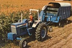 #Ford 8000 tractor with Ford silage chopper and wagon.