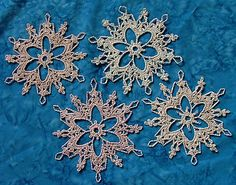 Ravelry: Grays Peak Snowflake pattern by Deborah Atkinson.  Another beautiful free snowflake pattern