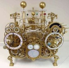 This clock has a 400 year perpetual calendar, shows the equation of time, sidereal time, sun/moon rise and set, moon's phase and age, tides, solar/lunar eclipses, has a planisphere, tellurium, and full-featured orrery to Saturn with functional moons. Solar And Lunar Eclipse, Solar Lunar, Equation Of Time, Moon Rise, Sun Moon, Skeleton Clock, Mechanical Clock, Clock Shop, Unique Clocks