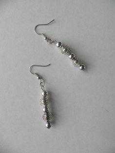 Handgemaakte oorbellen.De oorbellen bestaan uit 5 door assieshop