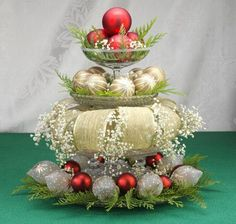 table-centerpiece with ornaments, ribbon,greenery and is that baby's breath?