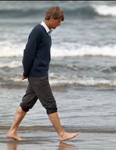 Senator Robert F. Kennedy thoughtfully walking the shores of Oregon in 1968.