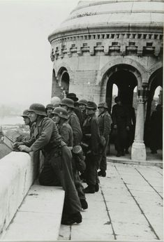Wehrmacht Heer Sturmartillerie/Assault gun soldiers on the Halászbástya (Fisherman's Bastion) overlooking the Danube River in Budapest,… German Soldiers Ww2, German Army, Luftwaffe, German Helmet, Germany Ww2, Ww2 Photos, War Photography, World War One, Historical Pictures
