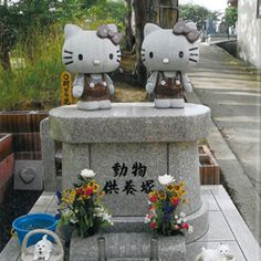 Hello Kitty grave markers: this looks to me like Kitty and her twin sister Mimi. Could it be a grave for twins?