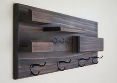 Coat hooks, mail storage, and a place for your necessities means an organized entryway! This Midnight Woodworks original design will help keep your busy household stylishly organized. Our handcrafted shelf, hook, pocket and ledge entryway organizer and is an excellent entryway storage solution. Perfect for your wallet or money clip, phone, mail, keys, coats, backpacks, electronics, sunglasses and other necessities! This large custom built flush-mount organizer is made using solid wood…