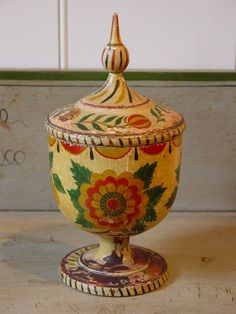 "A Rare Turned and Painted Wood Spice CupThe bowl-shaped body on a pedestal base with turned lid and elongated finial retains the original painted finish. Dimensions: Ht. 8 ¾"", D. 4 ¼""  Date / Circa: c. 1860  Maker / Origin: Attributed to the Stiehly family, Mahantongo Valley, PA  Medium: Lathe-turned maple  Miscellaneous: Scattered paint loss and wear w/ a yellowed shellac finish. Provenance: George Horace Lorimer Collection"