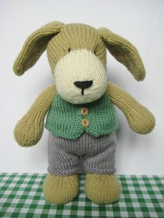 Puppy knitting pattern.  I purchased this pattern.  So glad I did.  He is adorable and easy, I converted him to knitting in the round, he' s all done but the vest. Will definitely make more than just one.