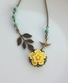 A Yellow Sakura Flower, Flying Swallow Bird, Leaf Branch with Green Pearls Necklace via Etsy.