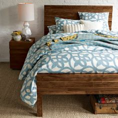 This is the gorgeous bed from West Elm that we have. It is made from reclaimed railway restles from India.