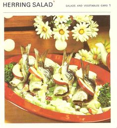 Apples and folded fish. And they call it a salad. Okay. Sure. I can't wait to suck on those fish tails, crunch on some apple slices.