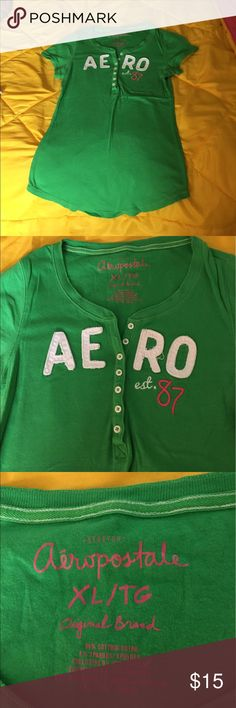 Aeropostale women's Xl top Aeropostale women's Xl top. GUC. Kelly green, white writing with pink. Henley style with buttons. Perfect for spring or summer. Looks great with shorts or skirts. Aeropostale Tops Tees - Short Sleeve