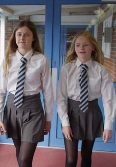 These two girls are on the way to the headmaster for a chat with his trusted slipper School Uniform Uk, British School Uniform, Catholic School Uniforms, Catholic School Girl, Cute School Uniforms, Girls Uniforms, School Girl Dress, Cute Little Girl Dresses, Plus Size Cocktail Dresses