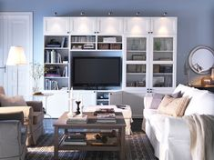 I want to plan an entertainment center like this one for the cut out in our living room!  But black.  And bigger.  And minus the lights on top.