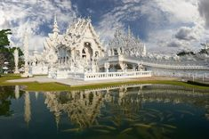 Beautiful ornate white temple located in Chiang Rai northern Thailand. Wat Rong Khun (White Temple), is a contemporary unconventional Buddhist temple.Buddhist and Hindu motifs. Mosques, Cathedrals, Cocos Island, White Temple, Chiang Rai, Northern Thailand, Buddhist Temple, Place Of Worship, Temples