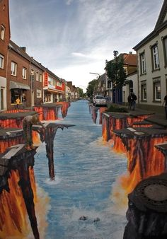 Street art : huge drawing of street collapsing into fire water ... by Edgar Mueller in Geldern, Germany