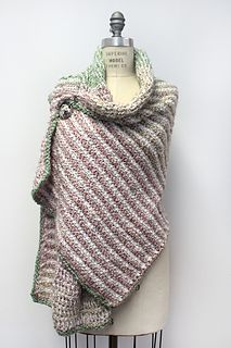 This comforting prayer shawl worked in Tunisian crochet evokes the warm colors and textures of a sun-washed Tuscan landscape. It is worked in two colorways, a variegated yarn alternating with a solid. You will need 2 skeins of each yarn.