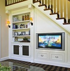 "Entertainment Center? Totally Cool! You know... I thought when I built my Cabin, I'd have tiny stairs or ladder.. but with all these great ideas for under stairs; I just HAVE to do a traditional staircase!! Could bookshelves be HINGED to reveal a 'secret room""? :)"