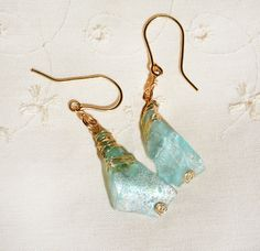 Roman Glass Rustic Earrings wrapped in Gold Filled by HKart1 Free Shipping Now! https://www.etsy.com/il-en/listing/224471130/roman-glass-rustic-earrings-wrapped-in?ref=shop_home_active_5