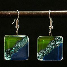 @Overstock - This lovely piece of jewelry is handcrafted in Chile by Juan Pablo Borcoski. These earrings celebrate the art of fused glass with a modern art design in the style of the artist Miro.http://www.overstock.com/Worldstock-Fair-Trade/Fused-Glass-Ocean-River-Meadow-Earrings-Chile/4655190/product.html?CID=214117 $10.99