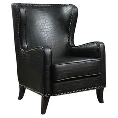 Wingback accent chair with crocodile-inspired upholstery and nailhead trim.   Product: ChairConstruction Material: ...