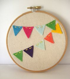 Bunting holiday decor. Save yourself $35 and DIY for less than half that. Felt flags, cotton fabric, sewing hoops, and embroidery thread.