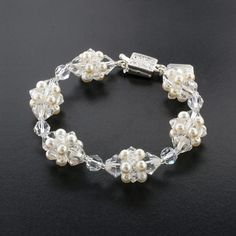 Crystal & Pearl Cluster Bracelet.  Made with Swarovski crystals and glass pearl.  Assembled in USA.