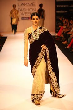Love the contrast on the saree! And the long layered necklace completes the look. --- Shyamal and Bhumika