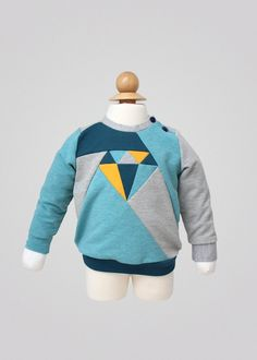 Dia Sweater PDF Sewing Pattern with an optional shoulder closure and puffed sleeves. Pattern for boys and girls