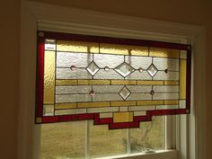 Interesting stained glass valance,    measures approximately 17 x30 inches. $350.