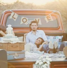 """truck bed picnic inspiration; minus the """"love"""" banner and lantern"""