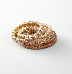 Stacking sparkly bracelets is a fun way to dress up your 9 to 5 outfit.