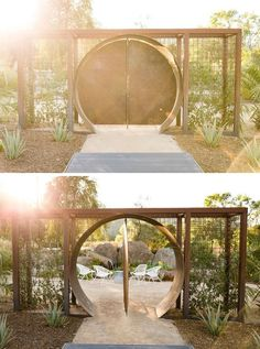 In this modern backyard, there's a circular steel doorway that opens to a peaceful sitting area. In this modern backyard, there's a circular steel doorway that opens to a peaceful sitting area.