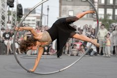 Angelica sur la roue Cyr - Angelica on the Cyr wheel by Indydan, via Flickr