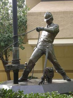 Texas A & M Aggies campus - Oil Rig Worker statue outside the petroleum engineering hall.