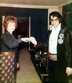 Elvis with Janelle McComb in the living room at Graceland. Vernon comissioned her to write the epitaph Elvis' tombstone. She was a close friend of the Presley's, and knew Elvis since he was 4 years old.