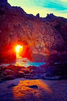 So amazing! Orange sunset peeking through rocks.