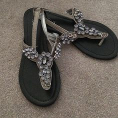 Jeweled sandals Gray/silver rhinestone sandals! Stylish and perfect for summer events! Unfortunately, the left shoe is missing two jewels and has a minor scuff (as pictured) PRICE IS FINAL Shoes Sandals