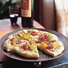 Garlic Flatbreads with Smoked Mozzarella and Tomato Vinaigrette | CookingLight.com