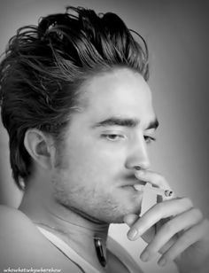 Rob Pattinson... hate that he's smoking, but he is hot.